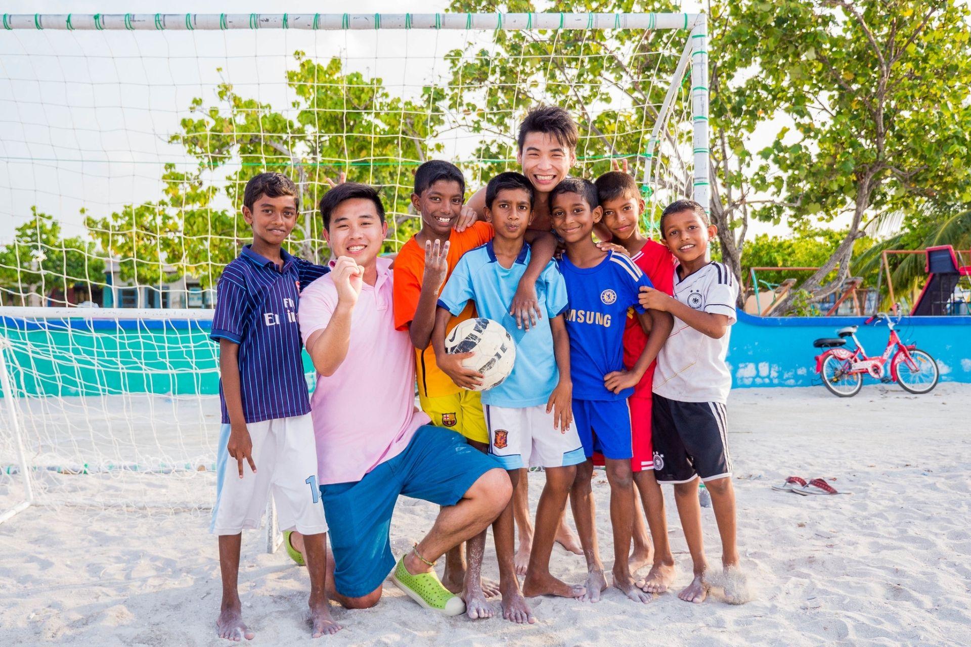 Kids Playing Football at Huraa Island - Full Day Maldives Adventure Trip